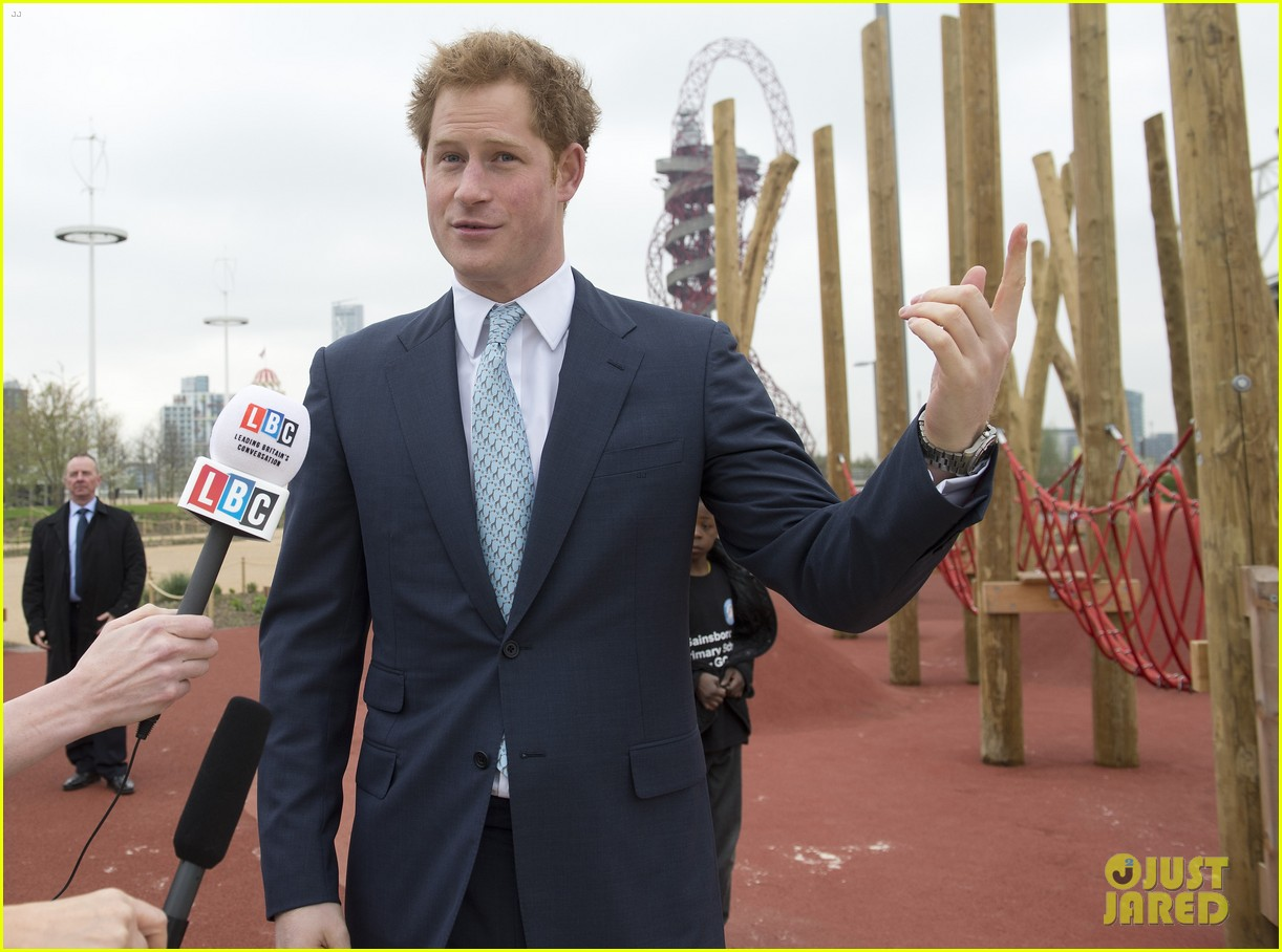 prince harry playing with kids at a playground 083084697