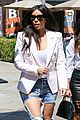 kim kardashian wears jeans with giant rips in them 07