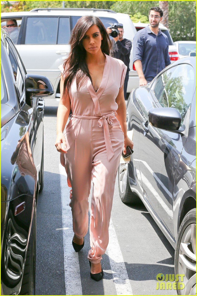 kim kardashian rocks pink jumpsuit with totally sheer back 07