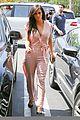 kim kardashian rocks pink jumpsuit with totally sheer back 14