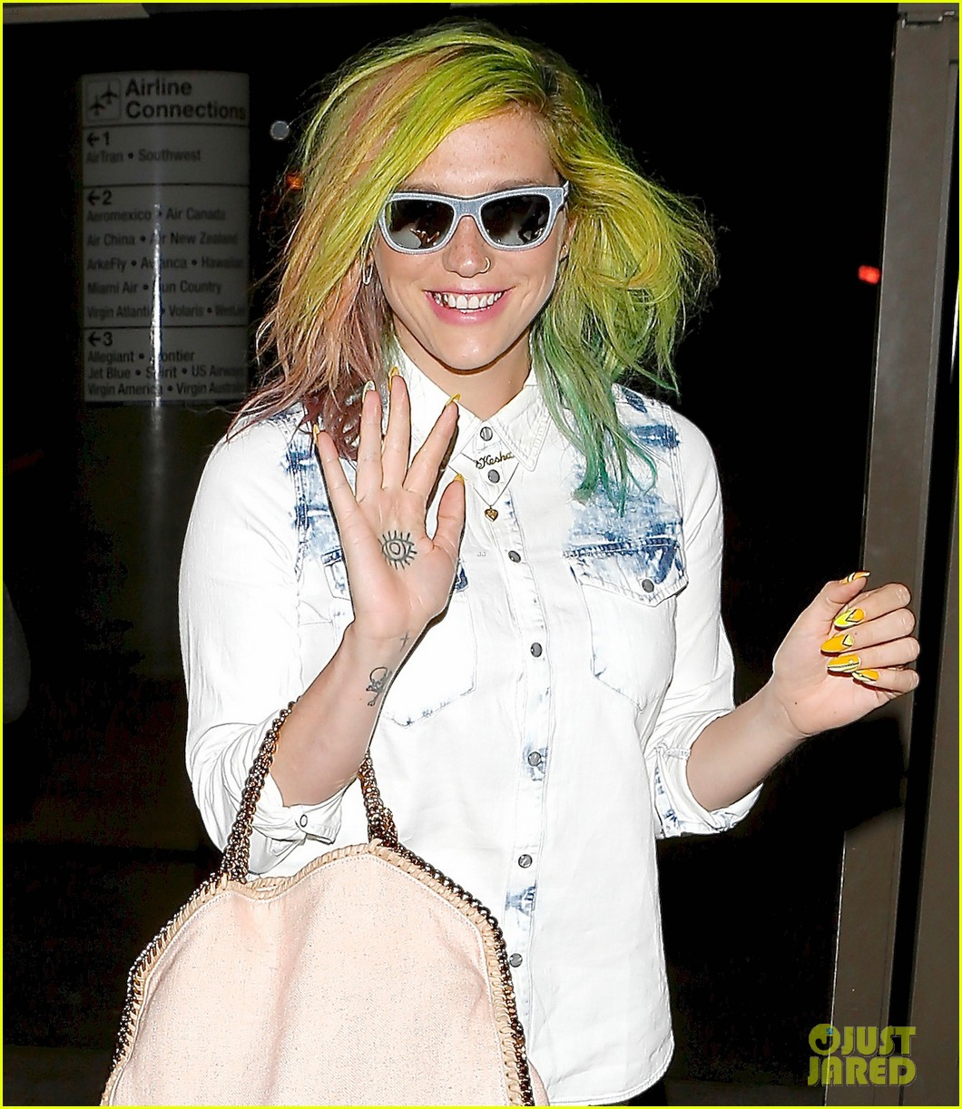 kesha happily departs from lax after attending coachella 02