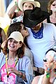 mila kunis reveals small baby bump in belly shirt packs on pda with ashton kutcher 04
