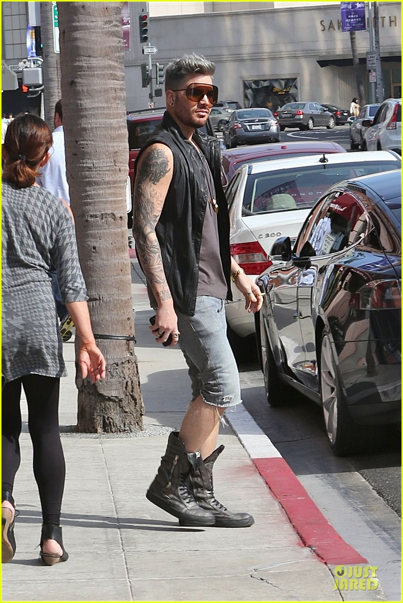 adam lambert tattooed guns sight you can miss 02