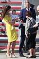 kate middleton changes into yellow dress to arrive in australia 19