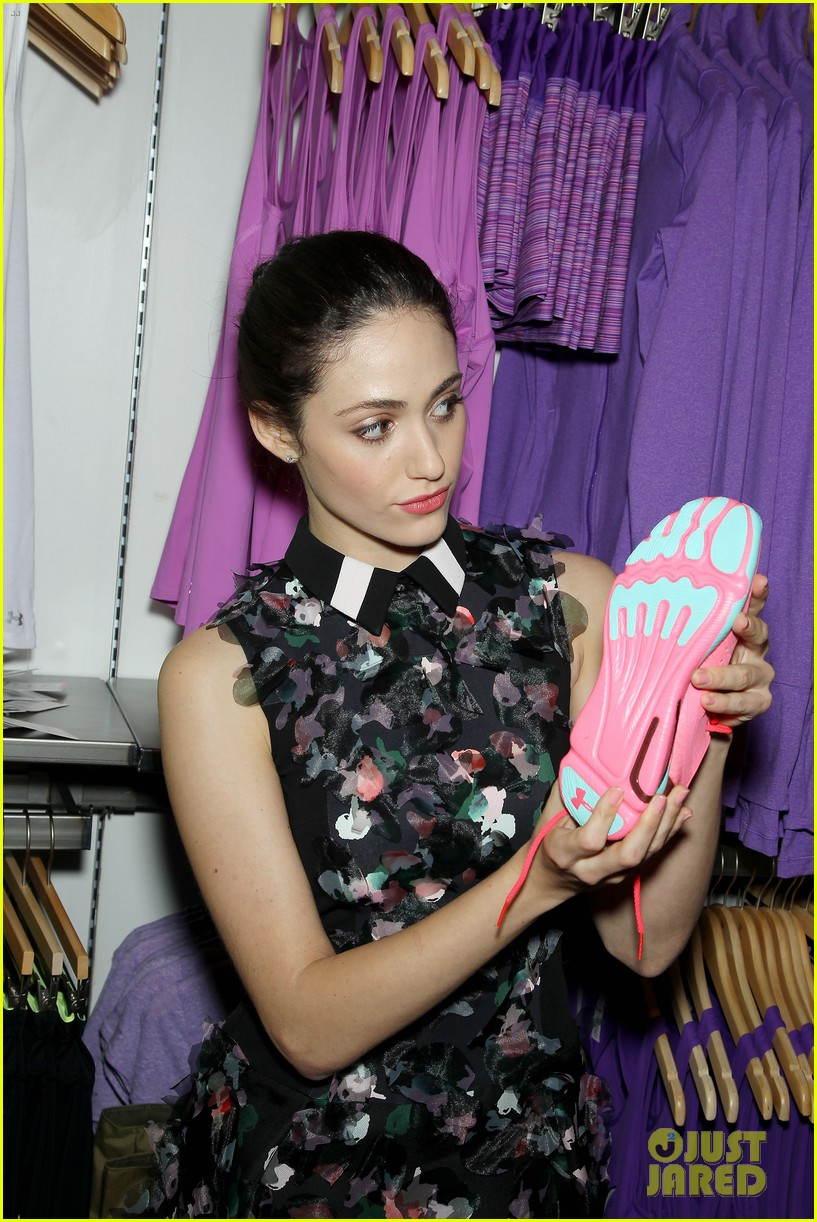 emmy rossum plays with shoes at under armour store launch 28