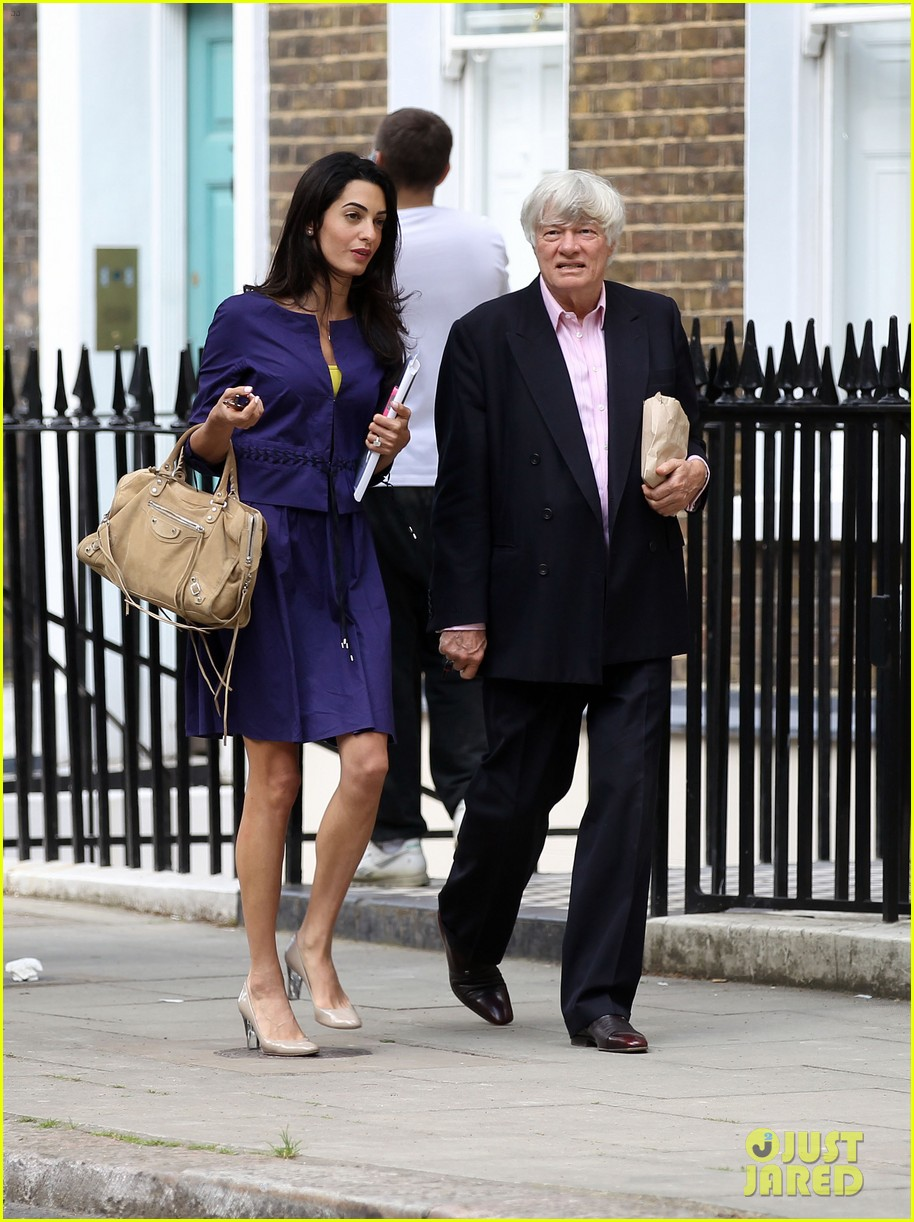 george clooneys fiancee amal alamuddin is back at work 103114479