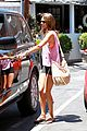 alessandra ambrosio shows off her super long legs in spandex shorts 03