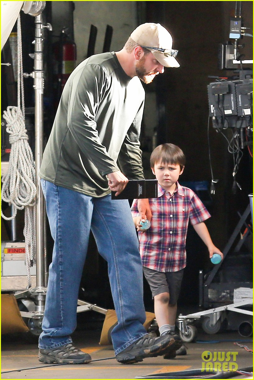 bradley cooper shows off his parenting skills on sniper set 013113501