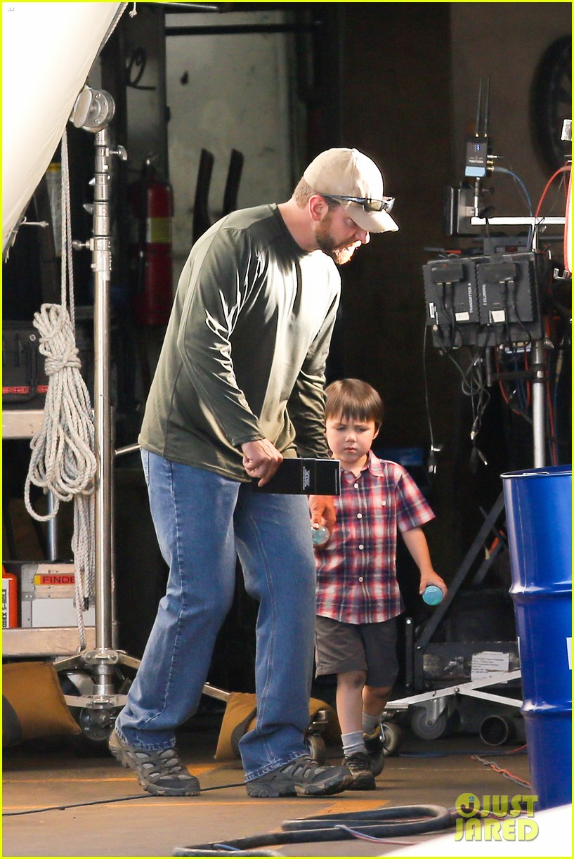bradley cooper shows off his parenting skills on sniper set 06