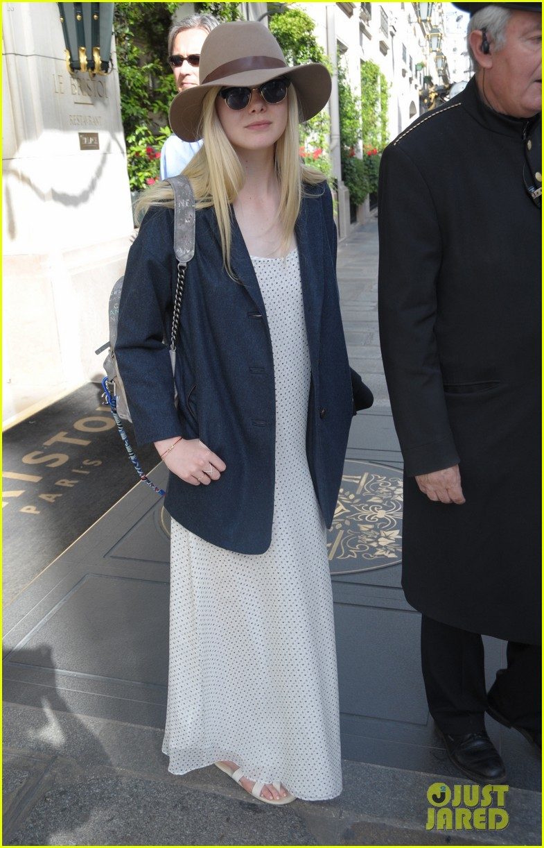 elle fanning looks like royalty at maleficent private reception 05
