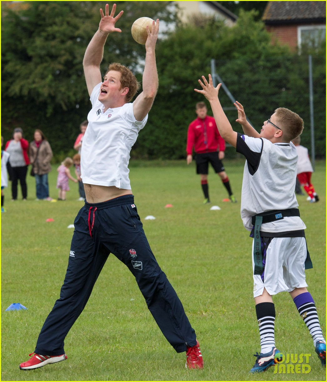 prince harry plays rugby schoolkids flashes his abs in the process 02