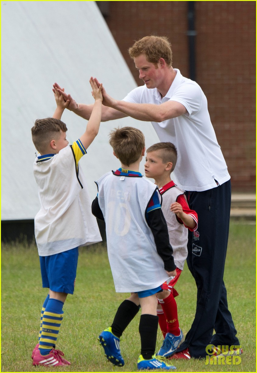 prince harry plays rugby schoolkids flashes his abs in the process 073123860