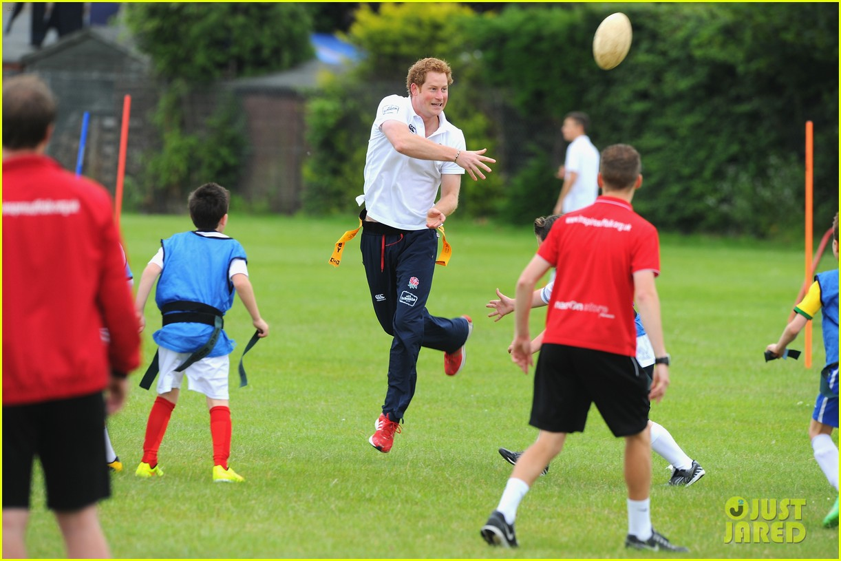prince harry plays rugby schoolkids flashes his abs in the process 103123863