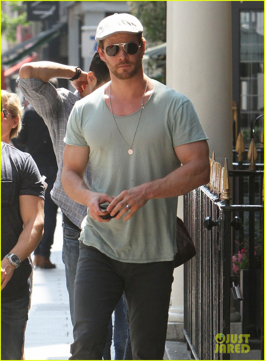 chris hemsworth pal is giving his muscles some competition 19
