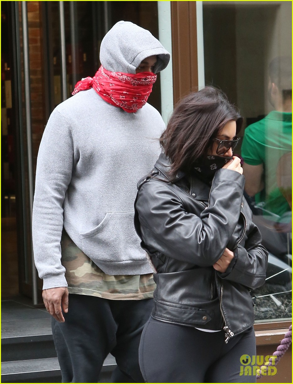 kim kardashian kanye west cover up their faces 143118104