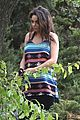 mila kunis hides her baby bump in loose fitting dress 04