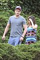 mila kunis hides her baby bump in loose fitting dress 07