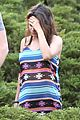 mila kunis hides her baby bump in loose fitting dress 10
