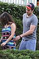 mila kunis hides her baby bump in loose fitting dress 11