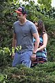 mila kunis hides her baby bump in loose fitting dress 23