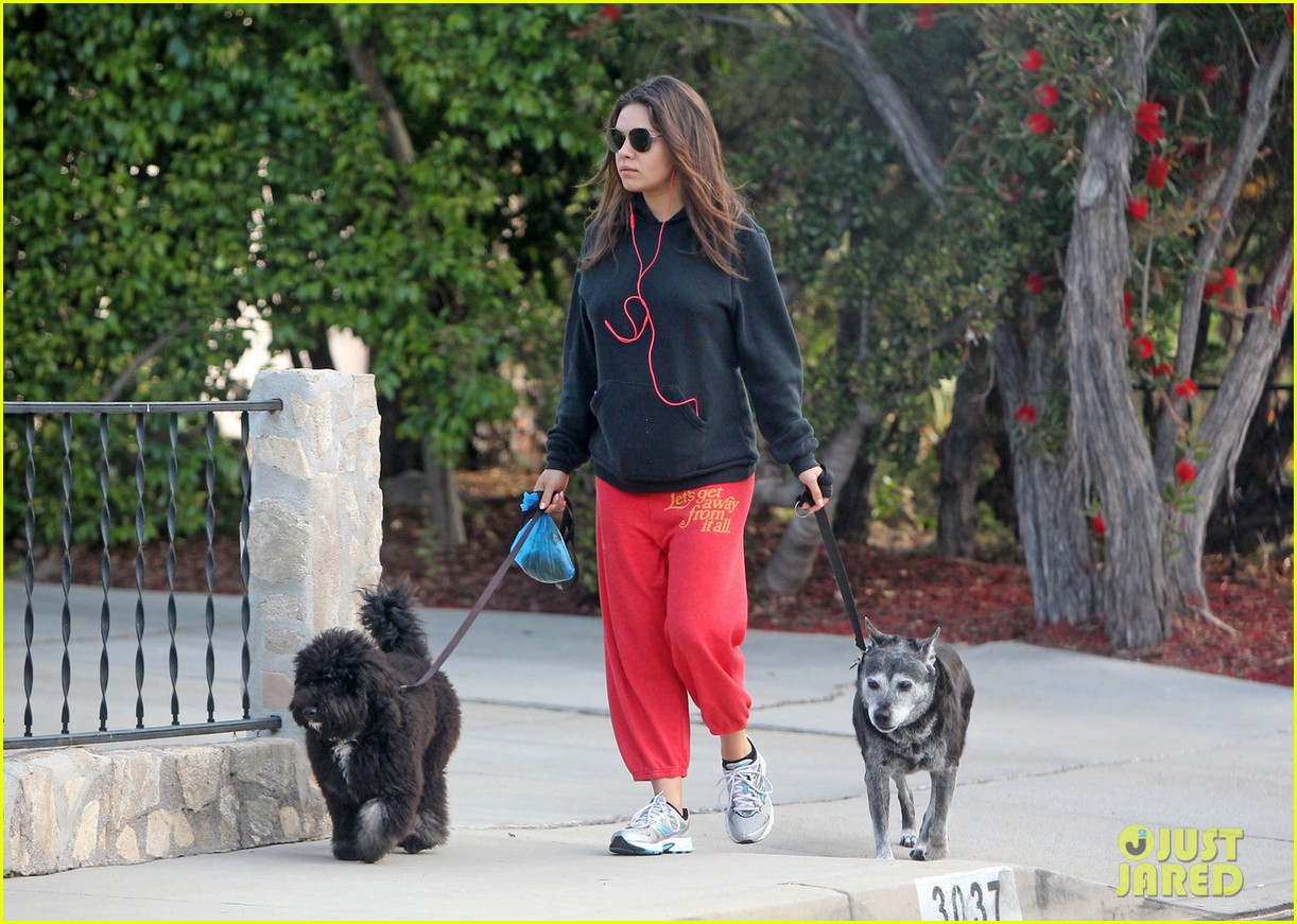 Photo of Mila Kunis & her Dog