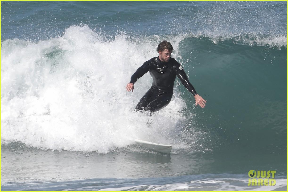 liam hemsworth hits waves malibu brother luke 22