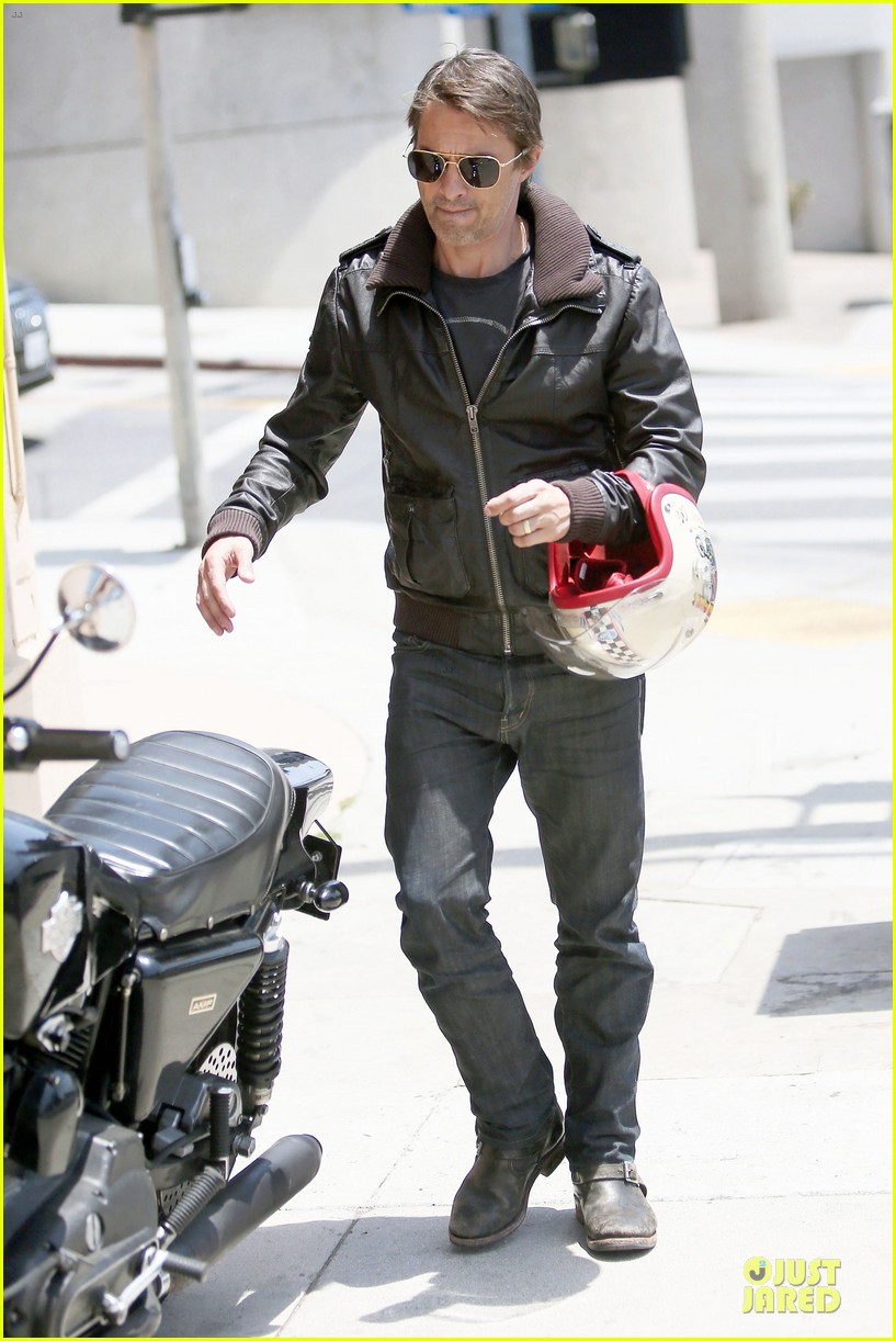 olivier martinez carrys motorcycle purse like a purse 013118661