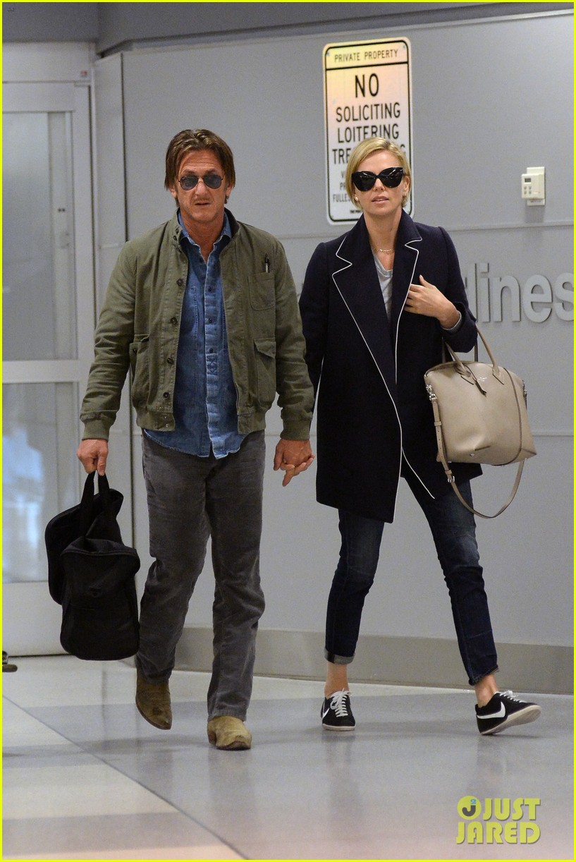 charlize theron sean penn hold hands upon new york arrival 10