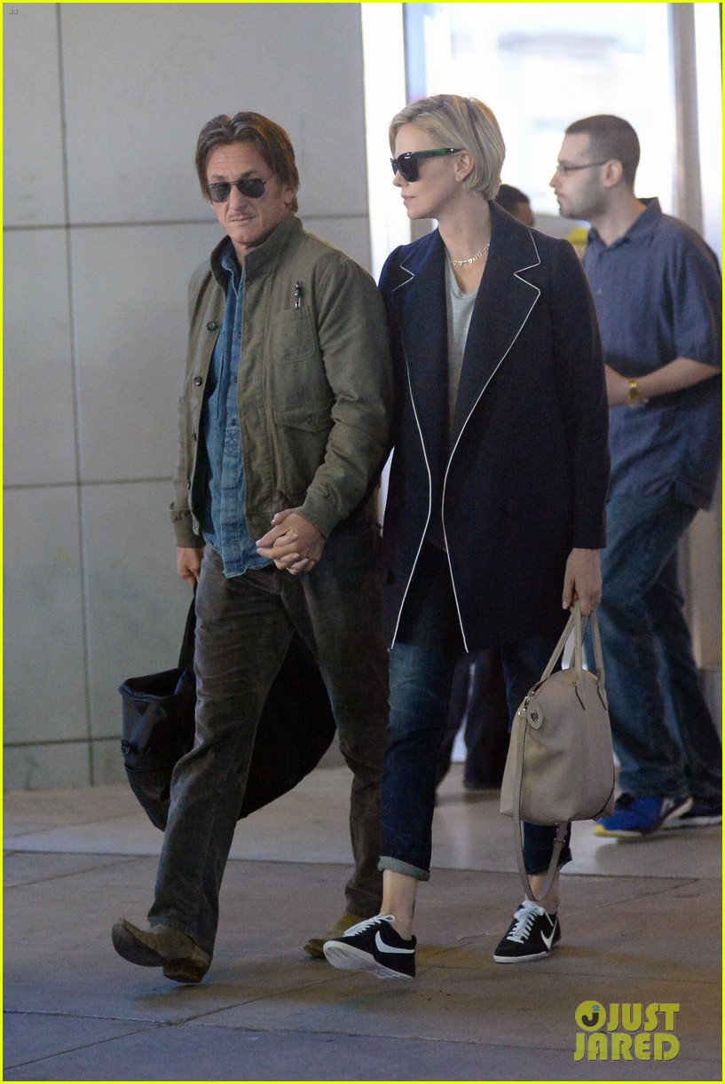 charlize theron sean penn hold hands upon new york arrival 253105579