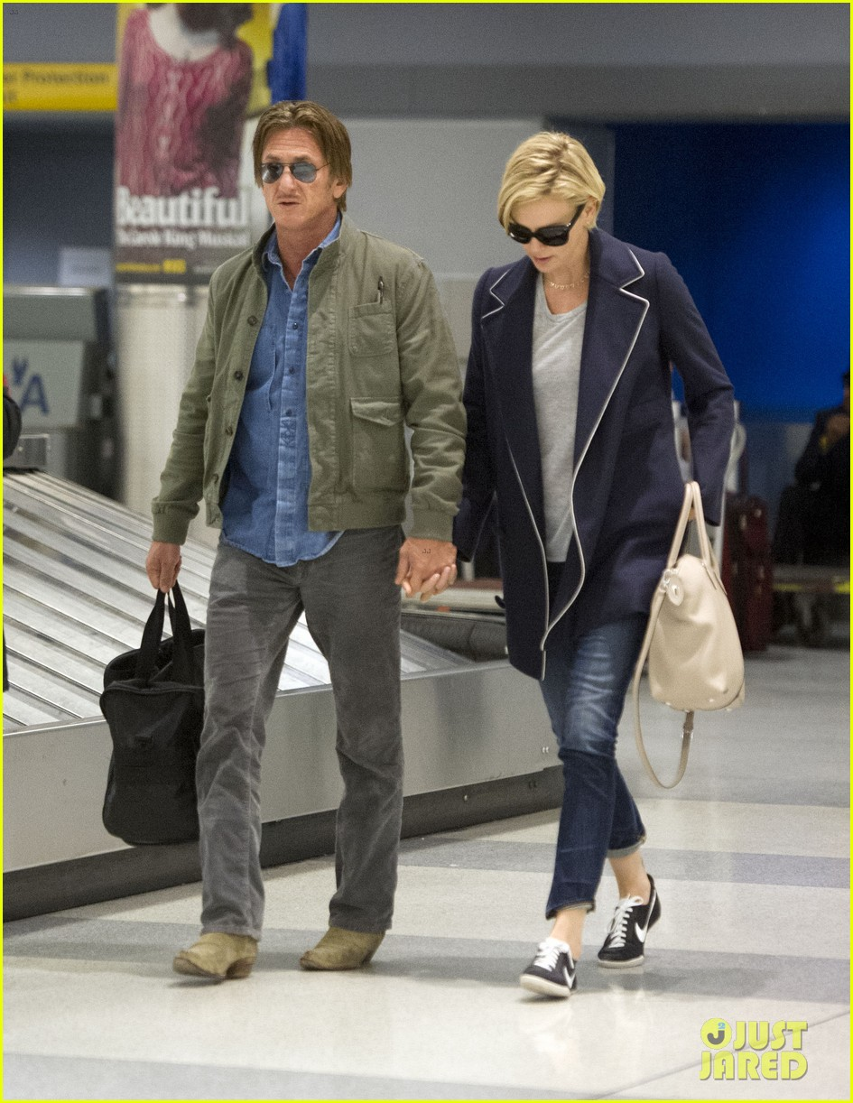 charlize theron sean penn hold hands upon new york arrival 313105585
