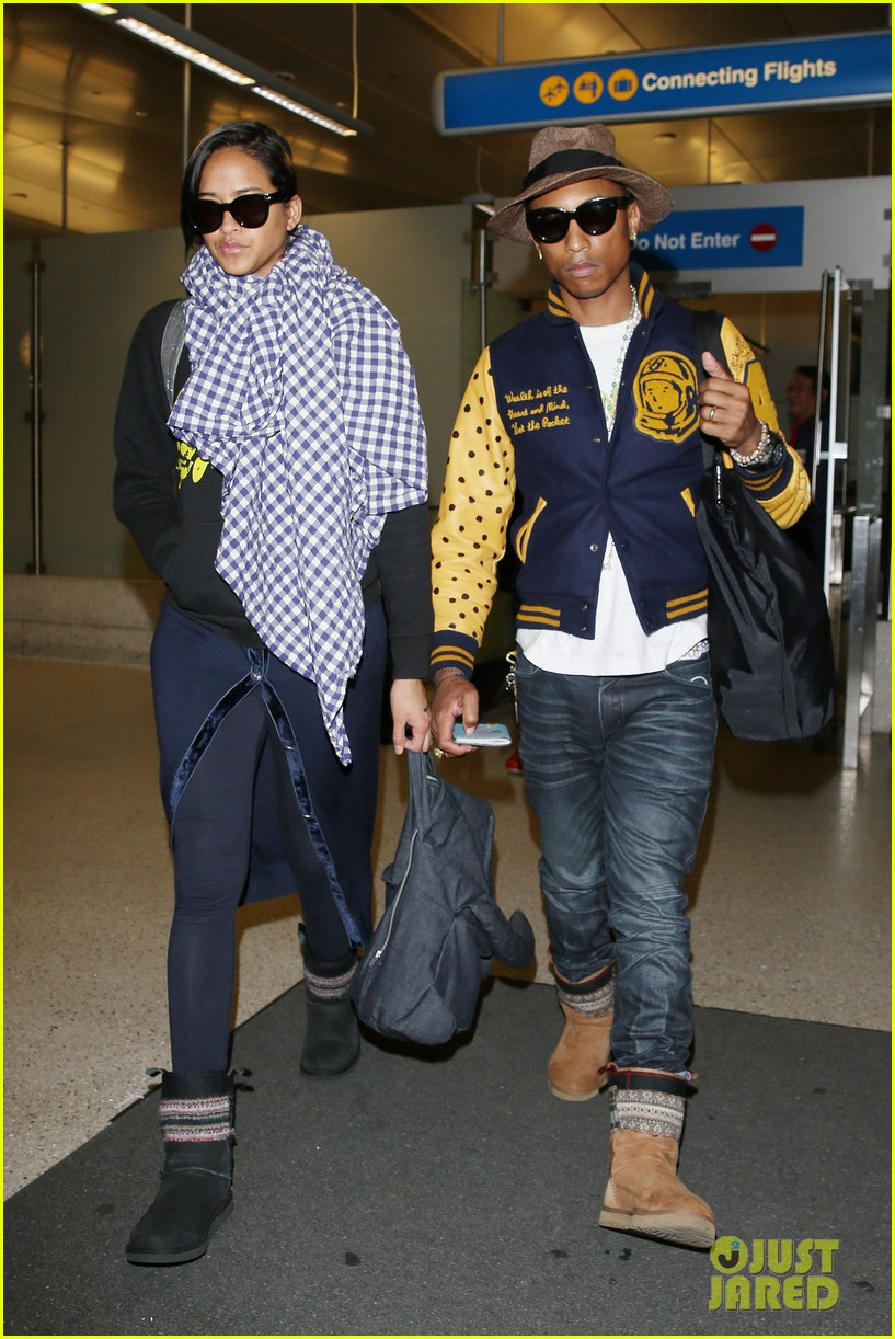 pharrell williams wife helen lasichanh look oh so serious 063124160