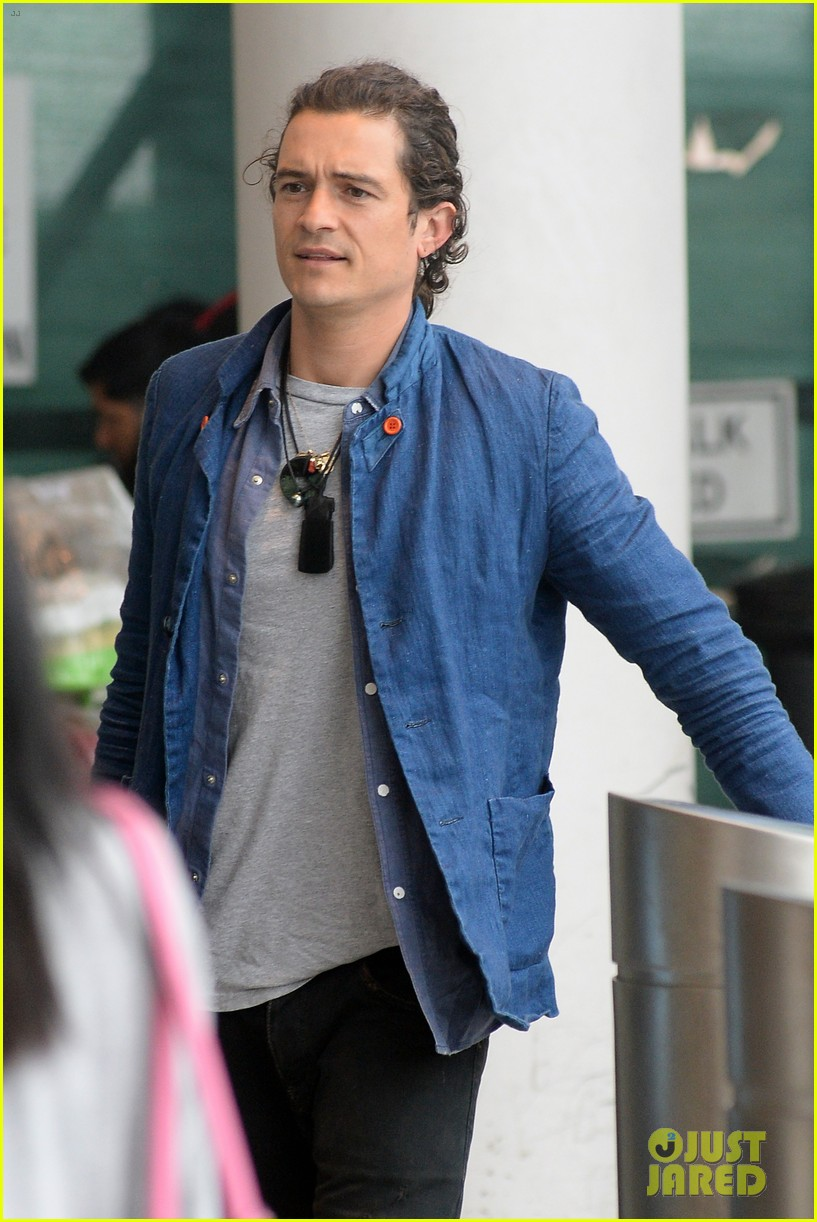 orlando bloom jets off after getting lap dance neil patrick harris 14