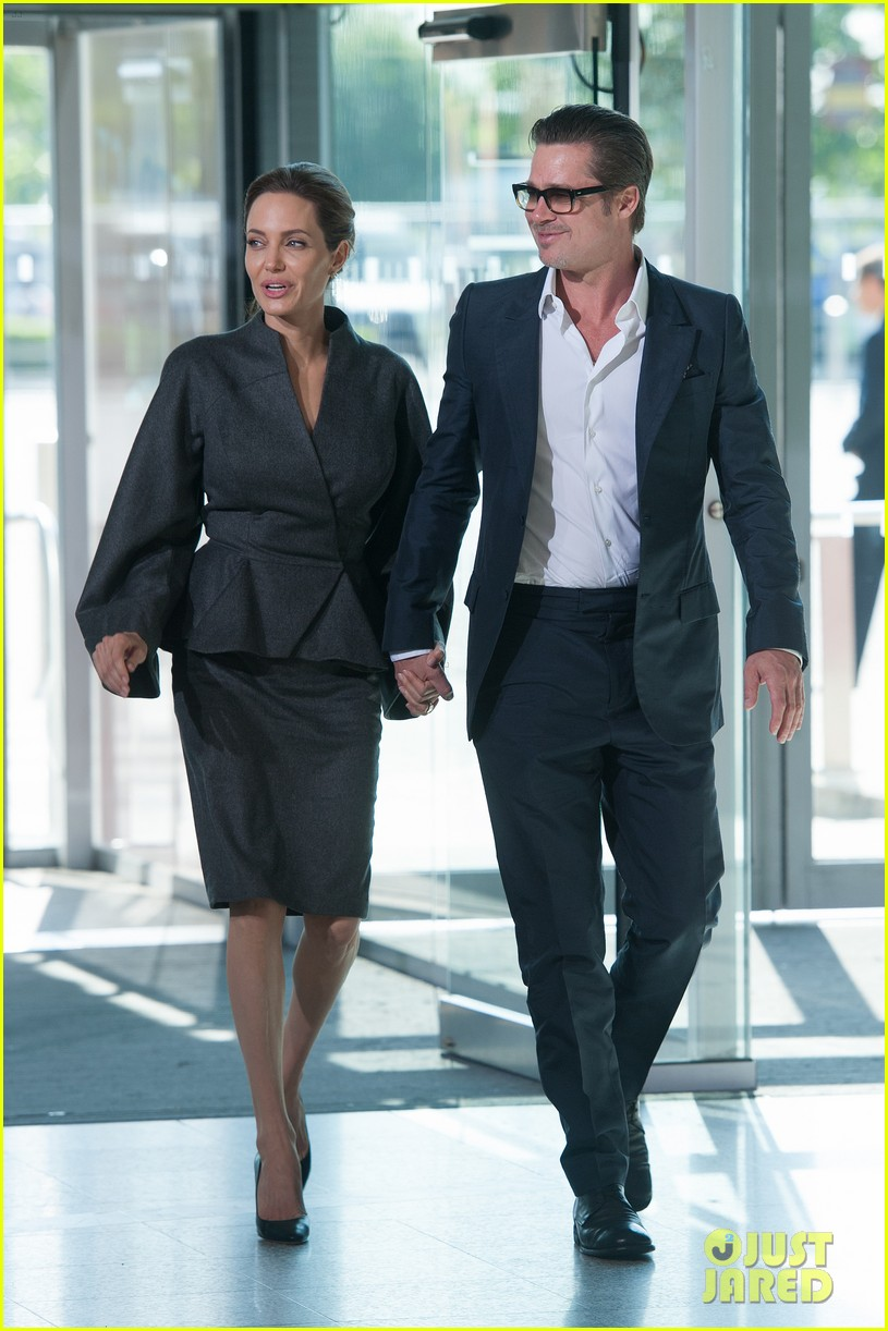 angelina jolie brad pitt keep hand in hand at the global summit end sexual violence 01