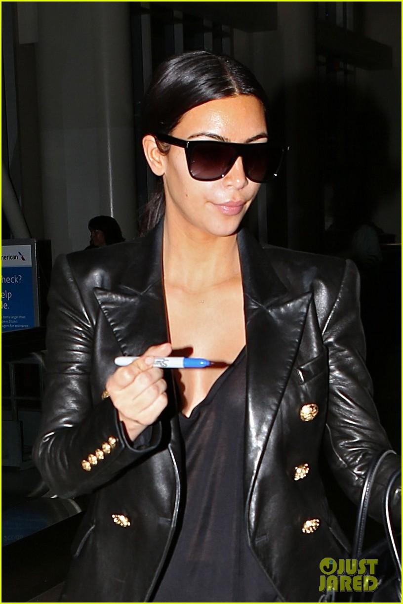 kim kardashian arrives at lax without new husband kanye west 033126203