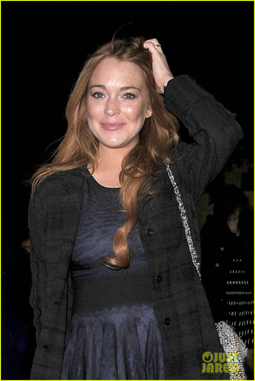 lindsay lohan changes up her look to evening wear for night out 04