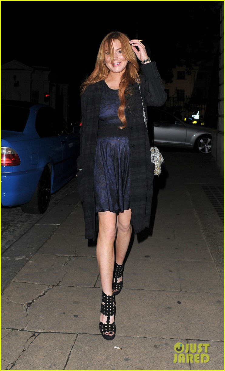 lindsay lohan changes up her look to evening wear for night out 173143031