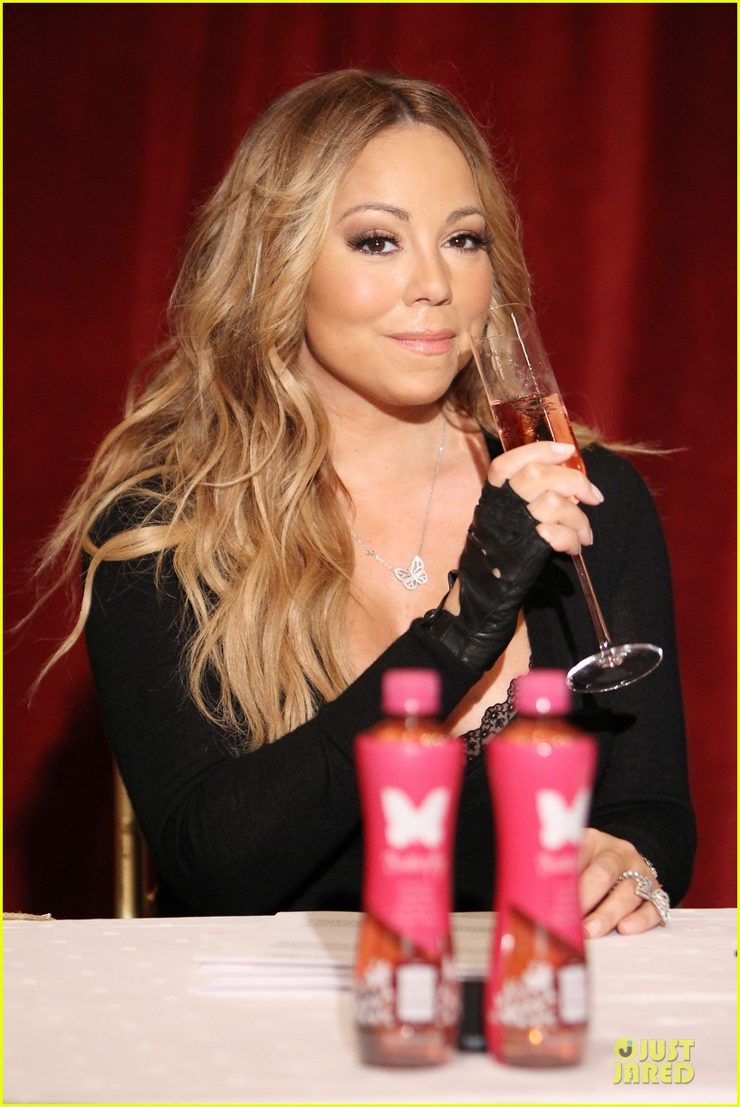 mariah carey bra gets exposure at butterfly launch 04