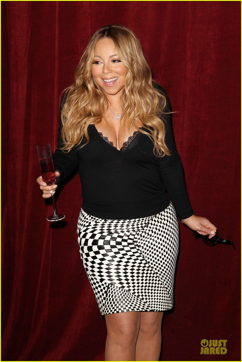 mariah carey bra gets exposure at butterfly launch 09