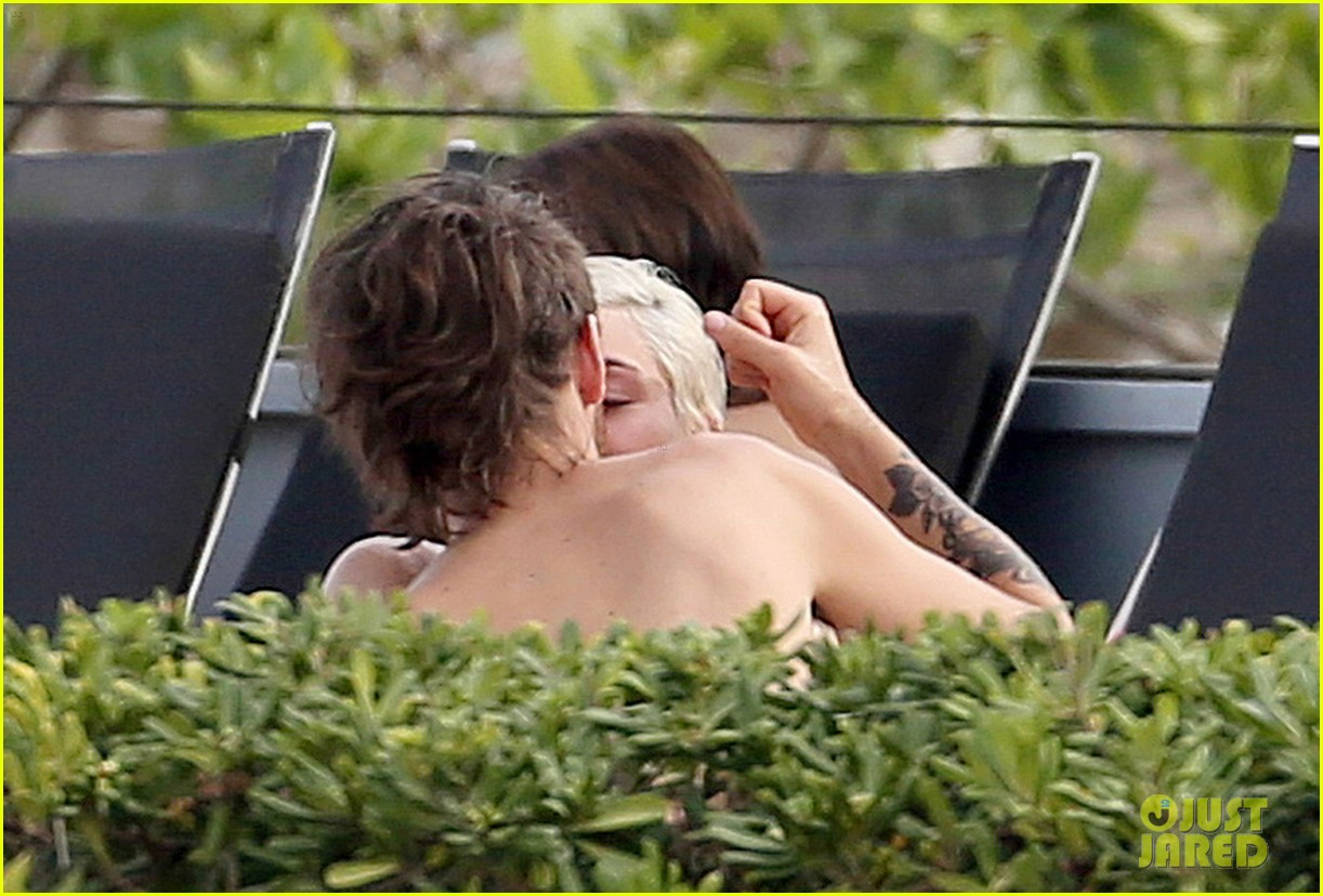 miley cyrus wears a bikini douses herself with water 033134802