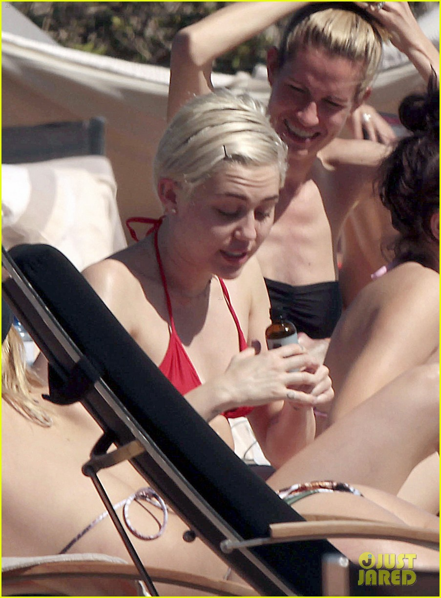 miley cyrus wears a bikini douses herself with water 263134825
