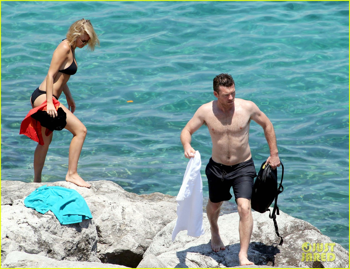 sam worthington lara bingle get handsy pack on the pda on beach 123134685