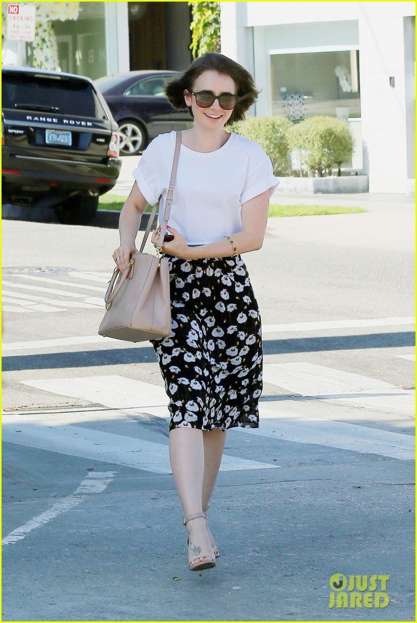 lily collins salon stop before holiday 063149240