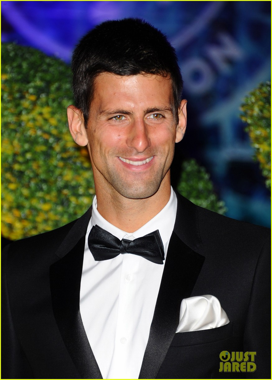 novak djokovic celebrates win at wimbledon championships winners ball 2014 083150866