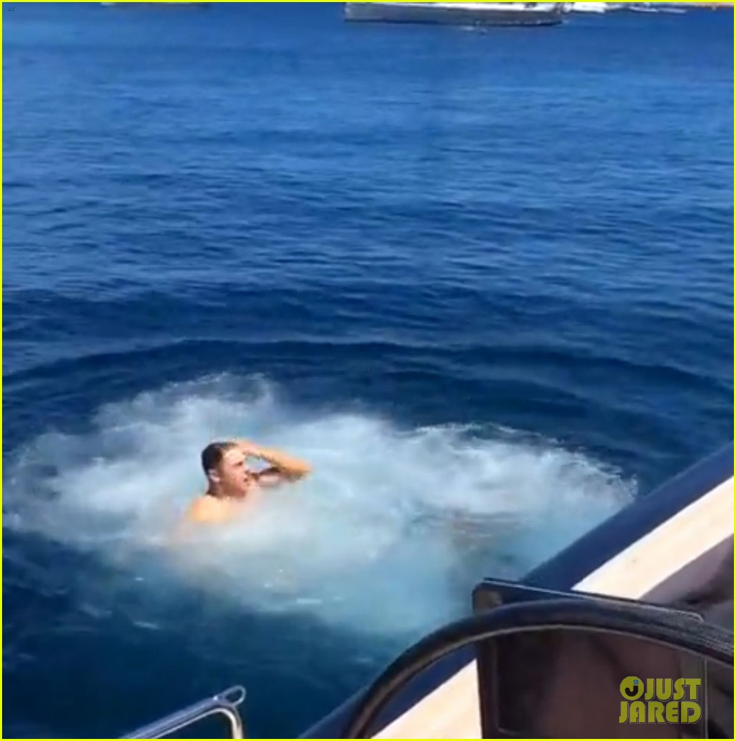 zac efron goes shirtless backflip off a boat 05