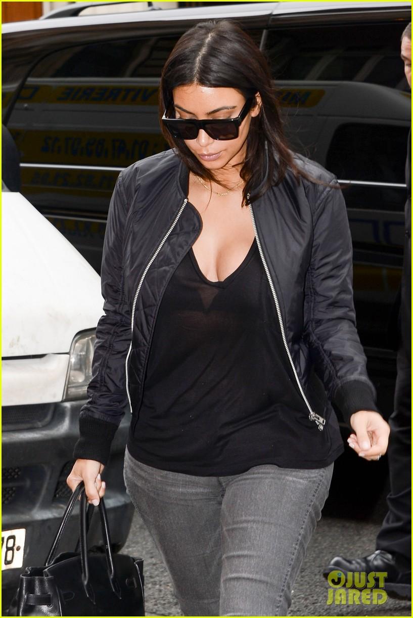 kim kardashian displays lots of cleavage for valentino fashion show 21
