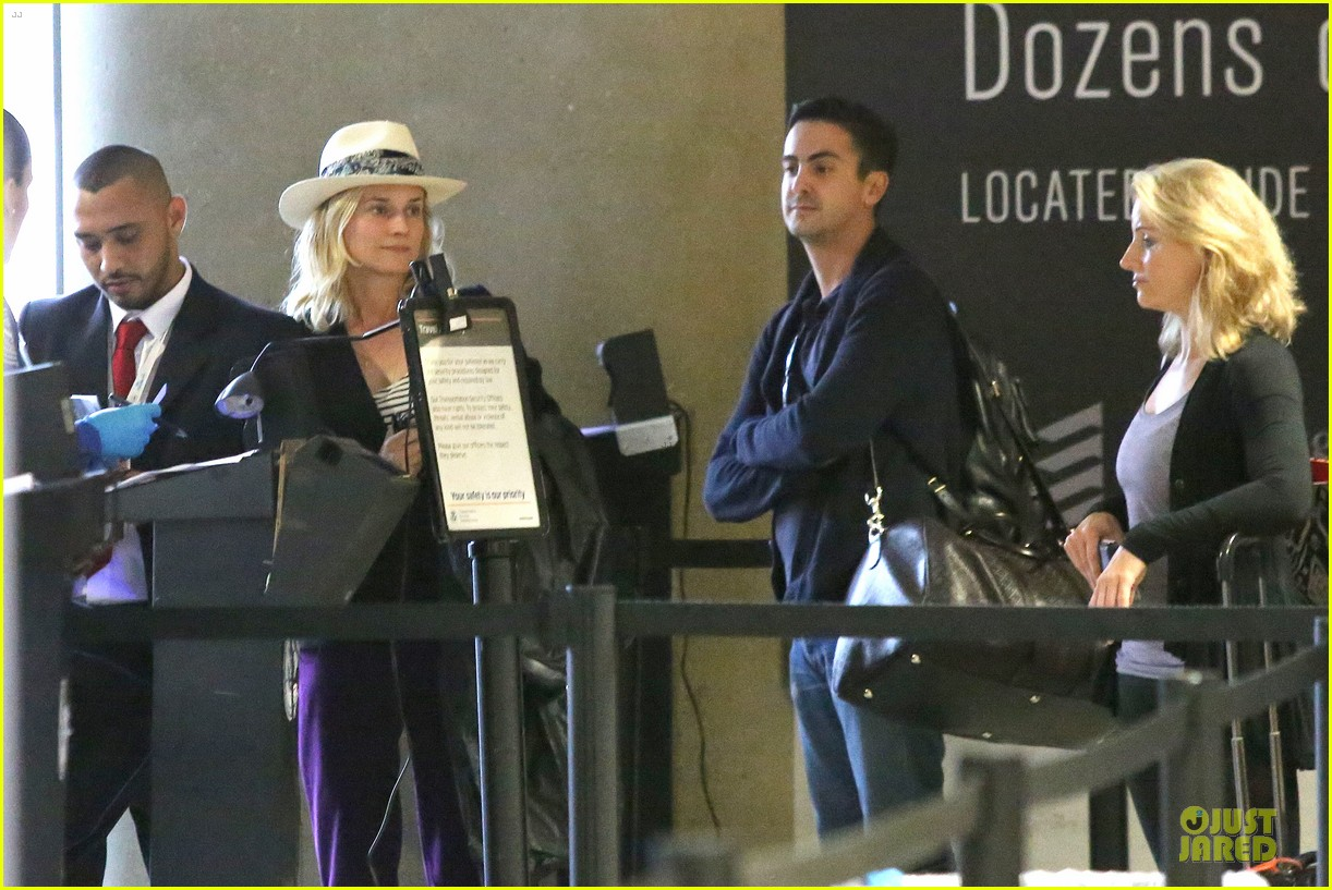 diane kruger wears purple pants at lax airport 15