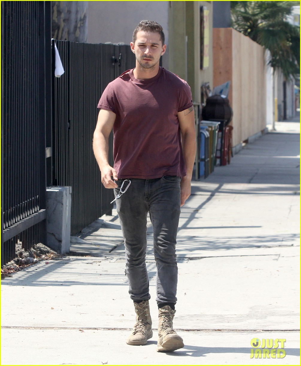 shia labeouf lifts his shirt bares torso 03