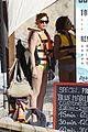 lindsay lohan wears a swimsuit with a totally sheer side 10