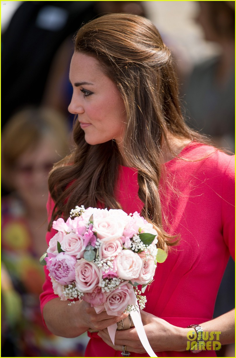 kate middleton is bright in pink for blessed sacrament school visit 09