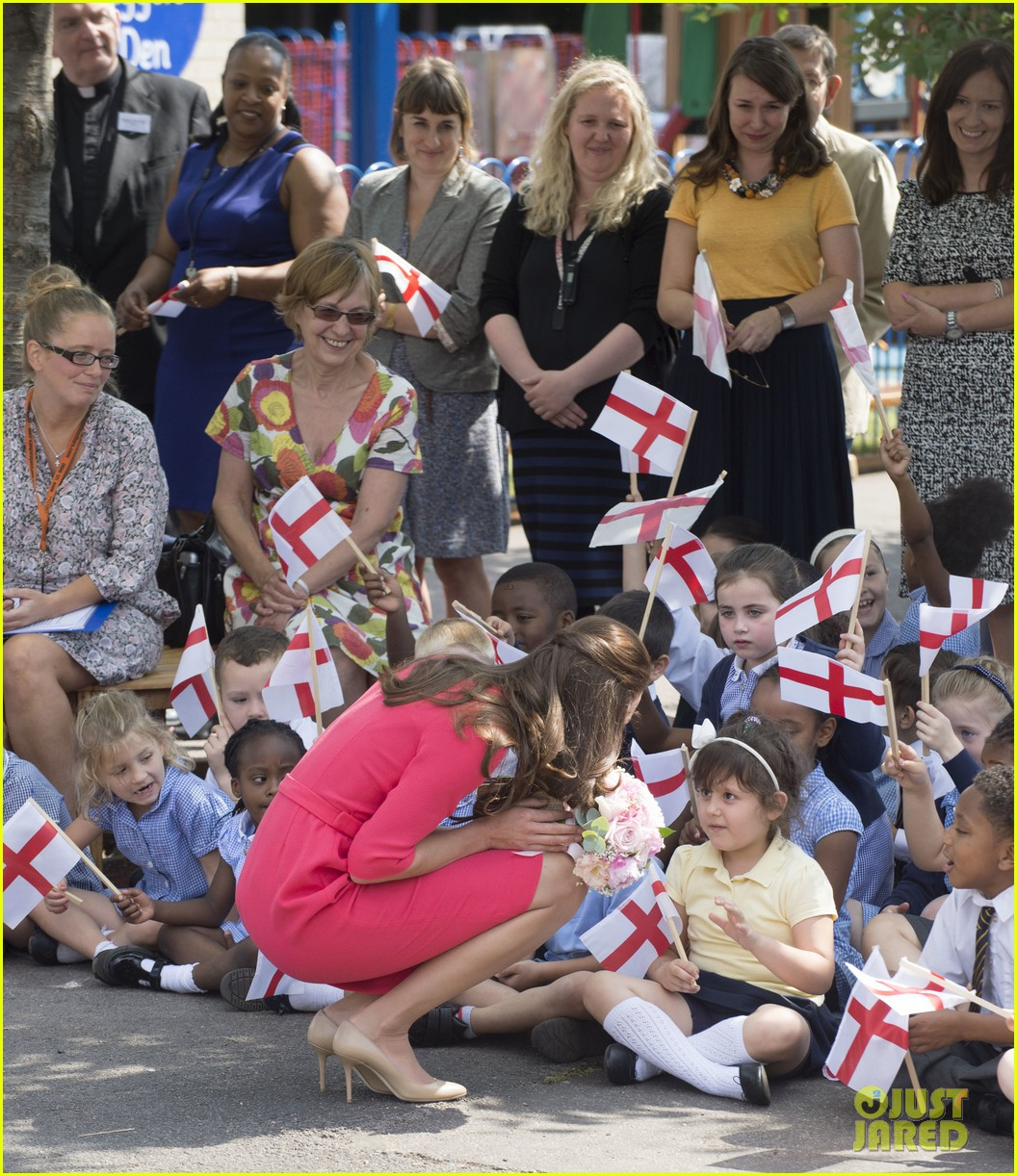 kate middleton is bright in pink for blessed sacrament school visit 14